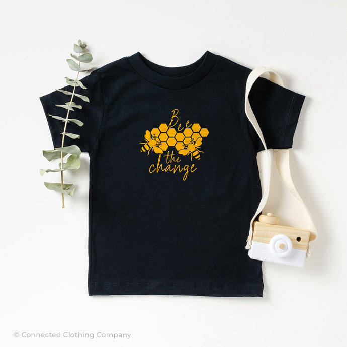 Bee The Change Toddler Short-Sleeve Tee in Black - Connected Clothing Company - 10% of profits donated to The Honeybee Conservancy, supporting bee conservation and building bee habitats