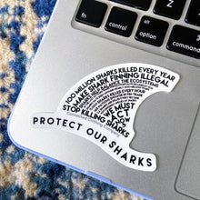Load image into Gallery viewer, Connected Clothing Company Protect Our Sharks Sticker on Macbook for size reference.
