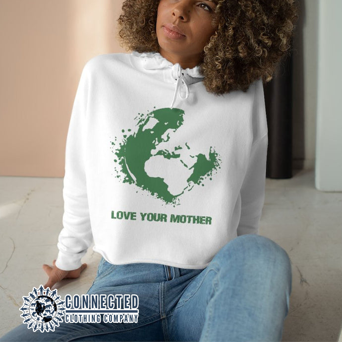 Model Wearing White Love Your Mother Earth Crop Hoodie - Connected Clothing Company - Ethically and Sustainably Made - 10% donated to the Environmental Defense Fund
