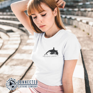 Model Wearing White Prevent Cruelty Orca Short-Sleeve Tee - Connected Clothing Company - Ethically and Sustainably Made - 10% donated to Humane Society International animal cruelty prevention