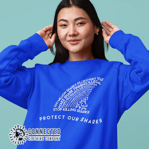 Model Wearing Royal Blue Protect Our Sharks Unisex Crewneck Sweatshirt - Connected Clothing Company - Ethically and Sustainably Made - 10% of profits donated to shark conservation and ocean conservation