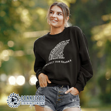 Load image into Gallery viewer, Model Wearing Black Protect Our Sharks Unisex Crewneck Sweatshirt - Connected Clothing Company - Ethically and Sustainably Made - 10% of profits donated to shark conservation and ocean conservation