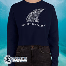 Load image into Gallery viewer, Model Wearing Navy Protect Our Sharks Crop Sweatshirt - Connected Clothing Company - Ethically and Sustainably Made - 10% of profits donated to shark conservation and ocean conservation