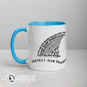 Right Side of Protect Our Sharks Mug With Blue Coloring on Inside, Rim, and Handle - Connected Clothing Company - Ethically and Sustainably Made - 10% donated to Oceana shark conservation