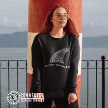 Load image into Gallery viewer, Model Wearing Black Protect Our Sharks Unisex Sweatshirt - Connected Clothing Company - 10% of profits donated to shark conservation