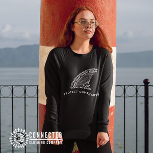 Model Wearing Black Protect Our Sharks Unisex Sweatshirt - Connected Clothing Company - 10% of profits donated to shark conservation