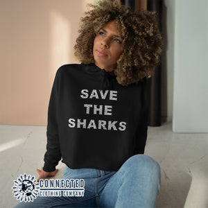 Model Wearing Black Save The Sharks Crop Hoodie - Connected Clothing Company - Ethically and Sustainably Made - 10% donated to Oceana shark conservation