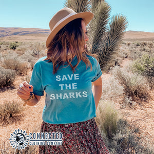 "Aqua Blue Save The Sharks Short-Sleeve Unisex T-Shirt reads ""Save The Sharks."" - Connected Clothing Company - Ethically and Sustainably Made - 10% donated to Oceana shark conservation"