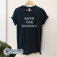 "Load image into Gallery viewer, Black Save The Sharks Short-Sleeve Unisex T-Shirt reads ""Save The Sharks."" - Connected Clothing Company - Ethically and Sustainably Made - 10% donated to Oceana shark conservation"