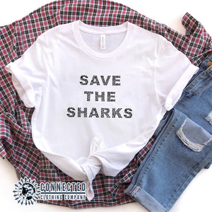 "White Save The Sharks Short-Sleeve Unisex T-Shirt reads ""Save The Sharks."" - Connected Clothing Company - Ethically and Sustainably Made - 10% donated to Oceana shark conservation"