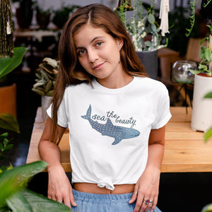 Model Wearing White Organic Cotton Sea The Beauty Whale Shark Short-Sleeve Tee - Connected Clothing Company - 10% of profits donated to ocean conservation