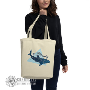 Model Holding Oyster Sea The Beauty Whale Shark Organic Cotton Eco Tote Bag - Connected Clothing Company - Ethically and Sustainably Made - 10% donated to Mission Blue ocean conservation