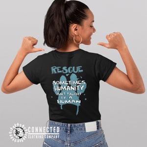 "Model Wearing Black Show Humanity Short-Sleeve Tee reads ""Rescue. Sometimes humanity isn't taught by a human"" - Connected Clothing Company - Ethically and Sustainably Made - 10% donated to animal rescue"