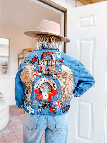 The Lion Queen sequined collage Denim Jacket.  Embroidered Lion Patch with sequined angel wings, sequined Queen patch, floral patches etc.