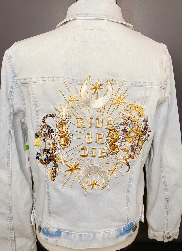 Ride Or Die with Snake Custom Embroidered on Light Blue Denim Jacket.  White/gold / black thread.