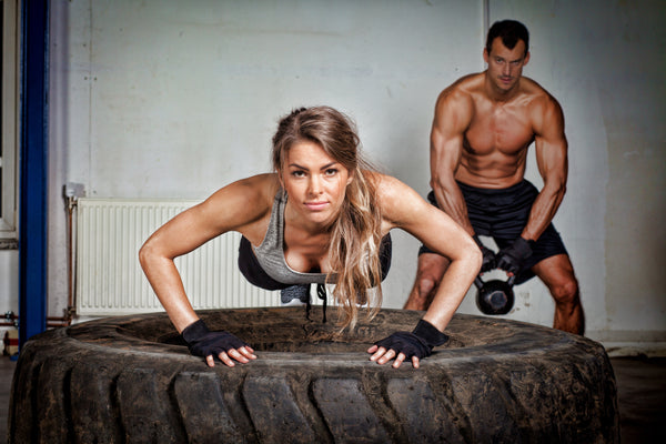 woman doing tire pushups
