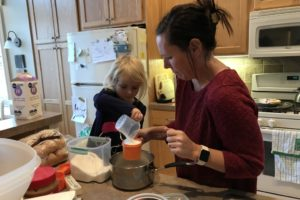 Child cooking with Mother