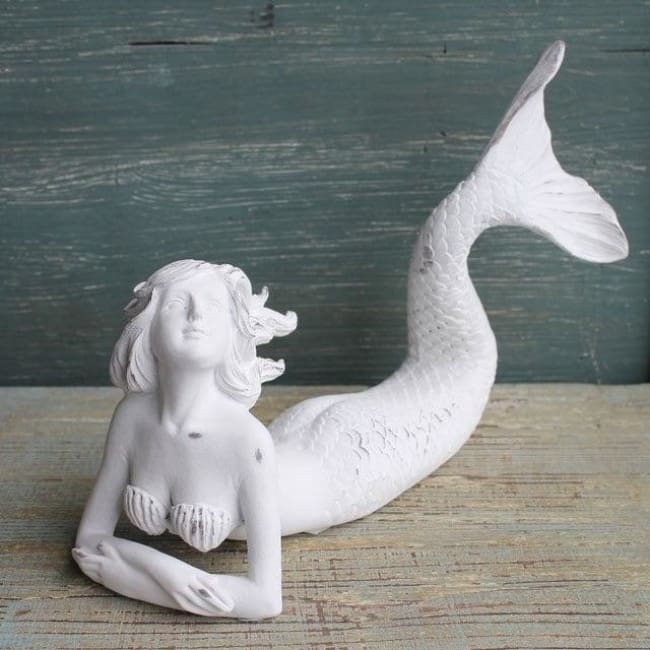 White Laying Down Mermaid Figurines $26.99