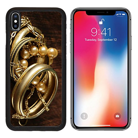 MSD Premium Apple iPhone X Aluminum Backplate Bumper Snap Case gold and pearl jewelry on vintage wooden background Image ID 27431890