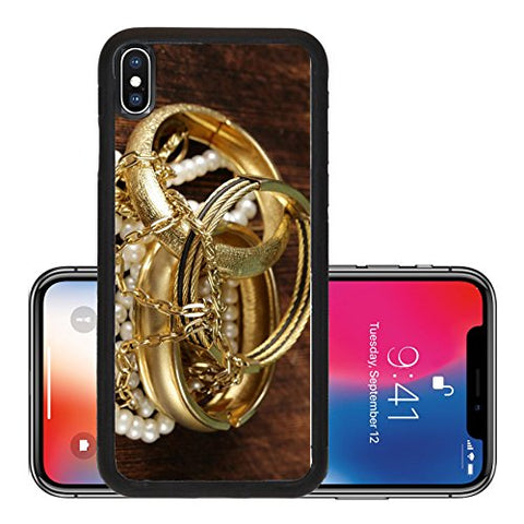 Liili Premium Apple iPhone X Aluminum Backplate Bumper Snap Case gold and pearl jewelry on vintage wooden background 27941360