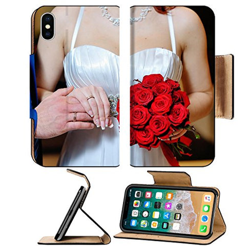 Luxlady Premium Apple iPhone X Flip Pu Leather Wallet Case IMAGE ID: 41865706 Hands with gold wedding rings bride and groom on the background of a bouquet of red flowers
