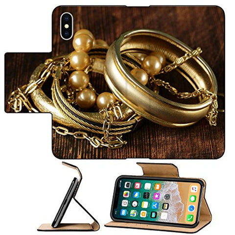 MSD Premium Apple iPhone X Flip Pu Leather Wallet Case gold and pearl jewelry on vintage wooden background Image ID 27431890
