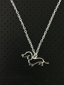 Dachlove.com New Cute Little Dachshund  Silver Necklace, Accessories- Dachshundloversonline  brings together dachshund merchandise, original and unique designed sausage dog gifts, accessories from all around the world.  The perfect addition to your dachshund loving home.  Find it in one store where you can buy them online and free shipping worldwide to your doorstep.