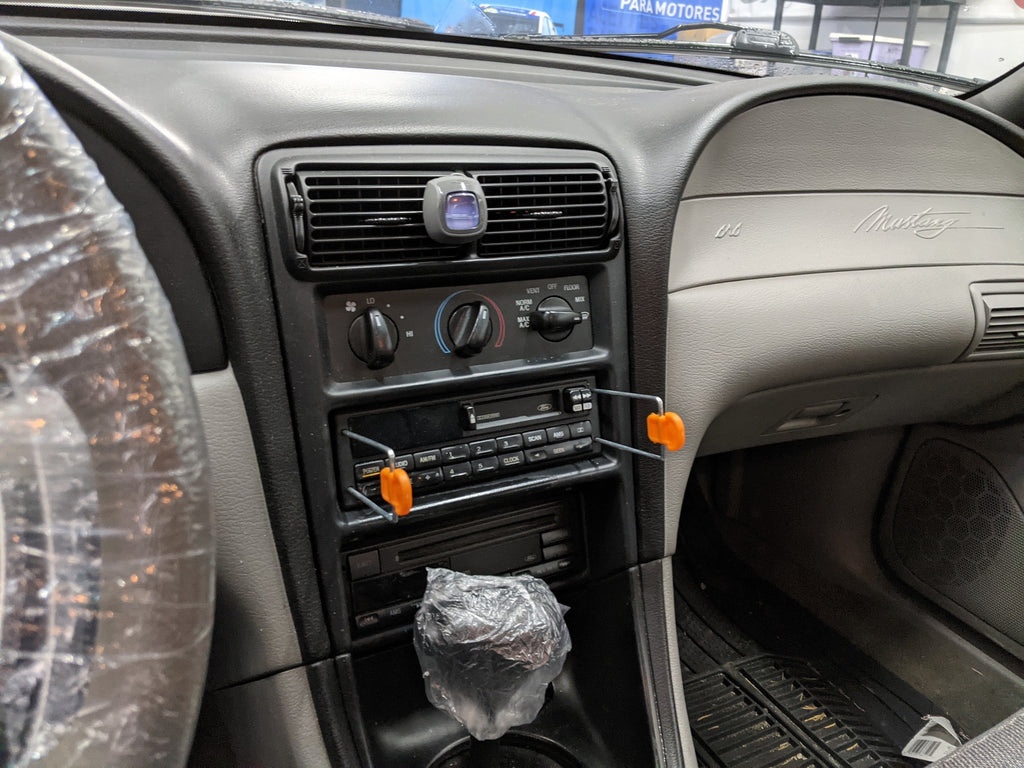 Ford Mustang SN-95 factory radio removal