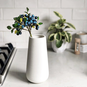 Artificial blueberries White ceramic vase