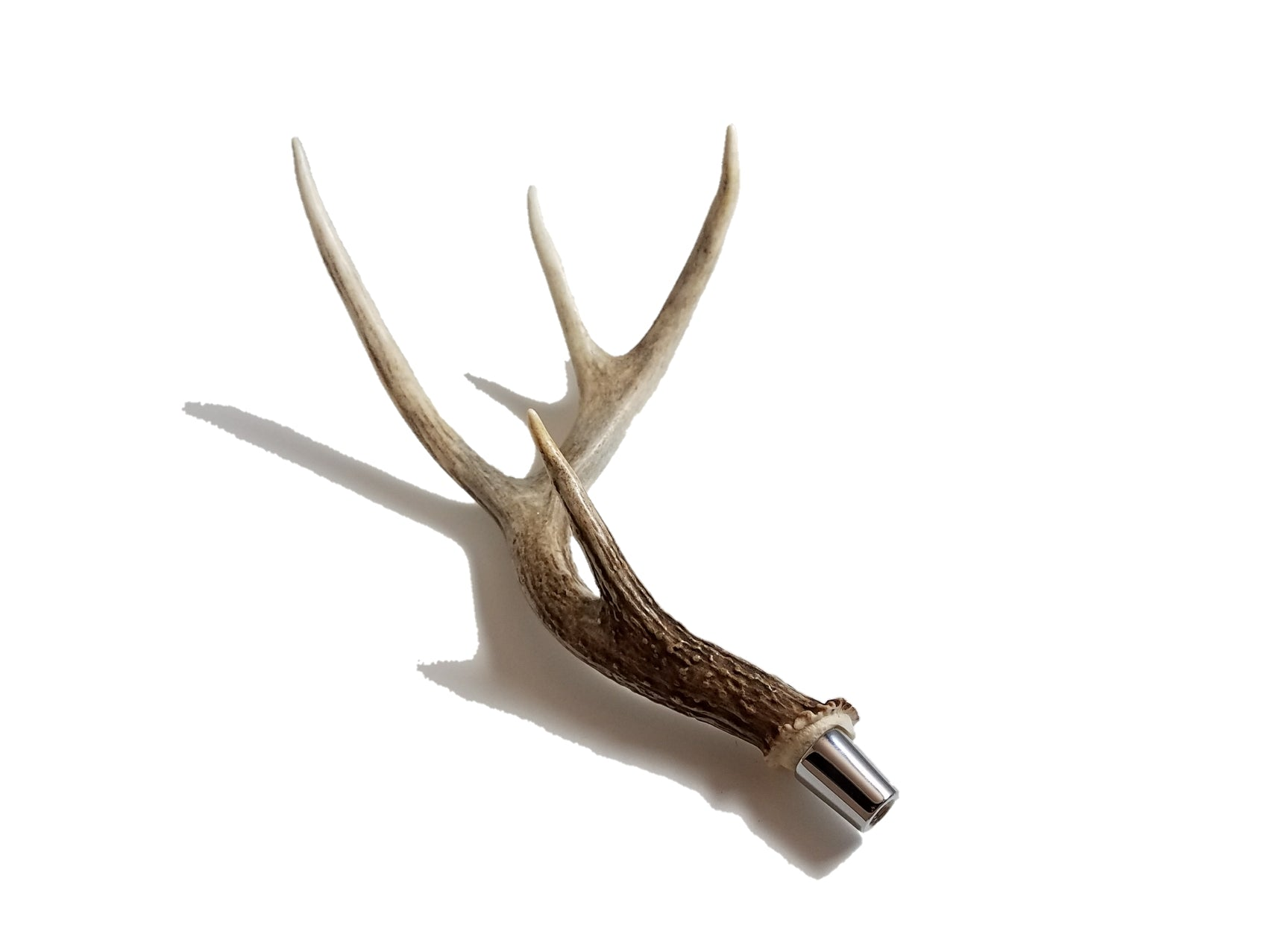 Whitetail antler beer tap handle (left) by Antler Artisans