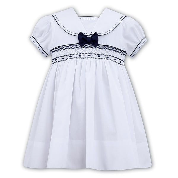 Sarah Louise Girls Smocked White & Navy Dress