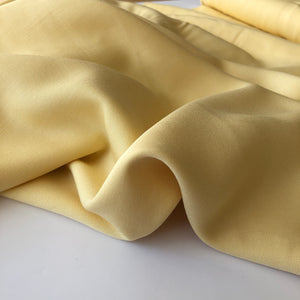 Grandeur Subtle Yellow Viscose Twill Dress Fabric