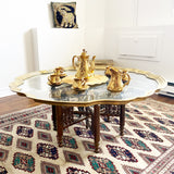 Brass and Glass Coffee Table with Carved Folding Wooden Legs