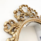 Small Ornate Gold Framed Bow Mirror