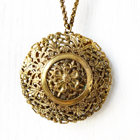 Large Ornate Gold Pendant on Long Chain