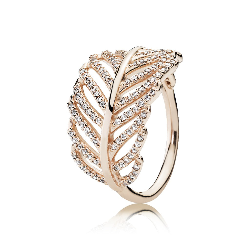 A gold feather ring by Pandora.