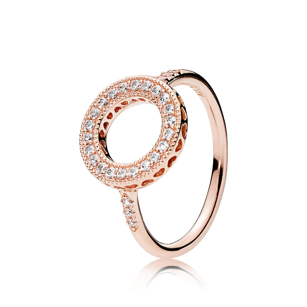 Ring in PANDORA Rose with clear cubic zirconia and milgrain details