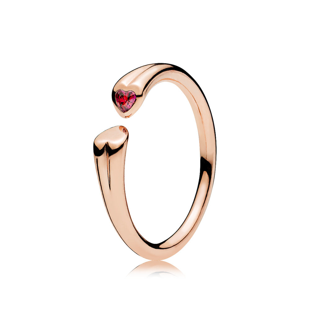 Two hearts open ring in PANDORA Rose with 1 flush-set heart-shaped step dome-cut red cubic zirconia
