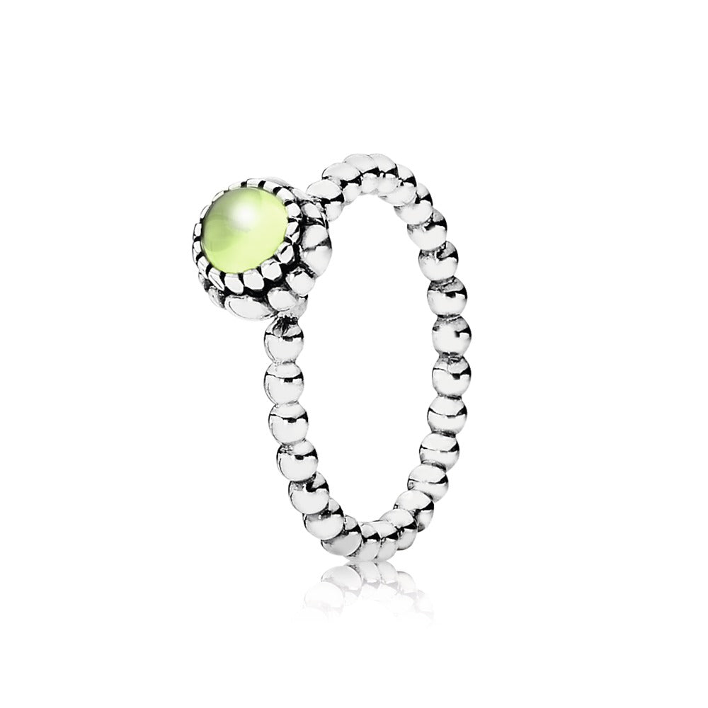 A ring with birthday blooms and Peridot in it by Pandora.