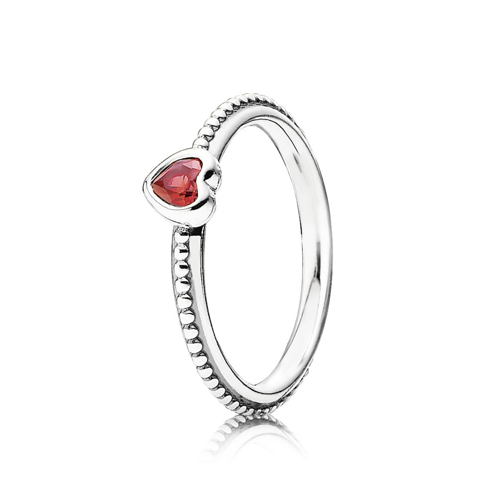 A red synthetic ruby Pandora ring.