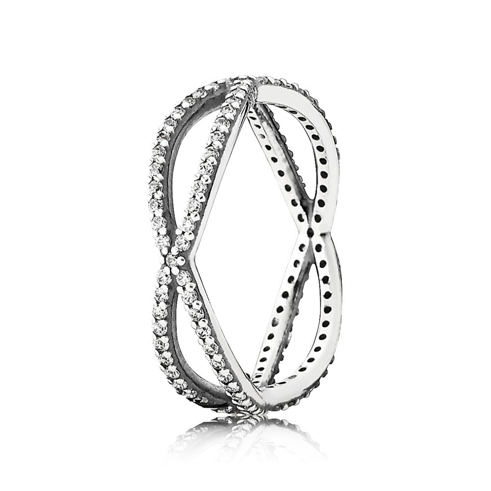 A charm titled Crossing Paths with cubic zirconia by Pandora.