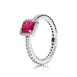 Ring in sterling silver with synthetic ruby and clear cubic zirconia