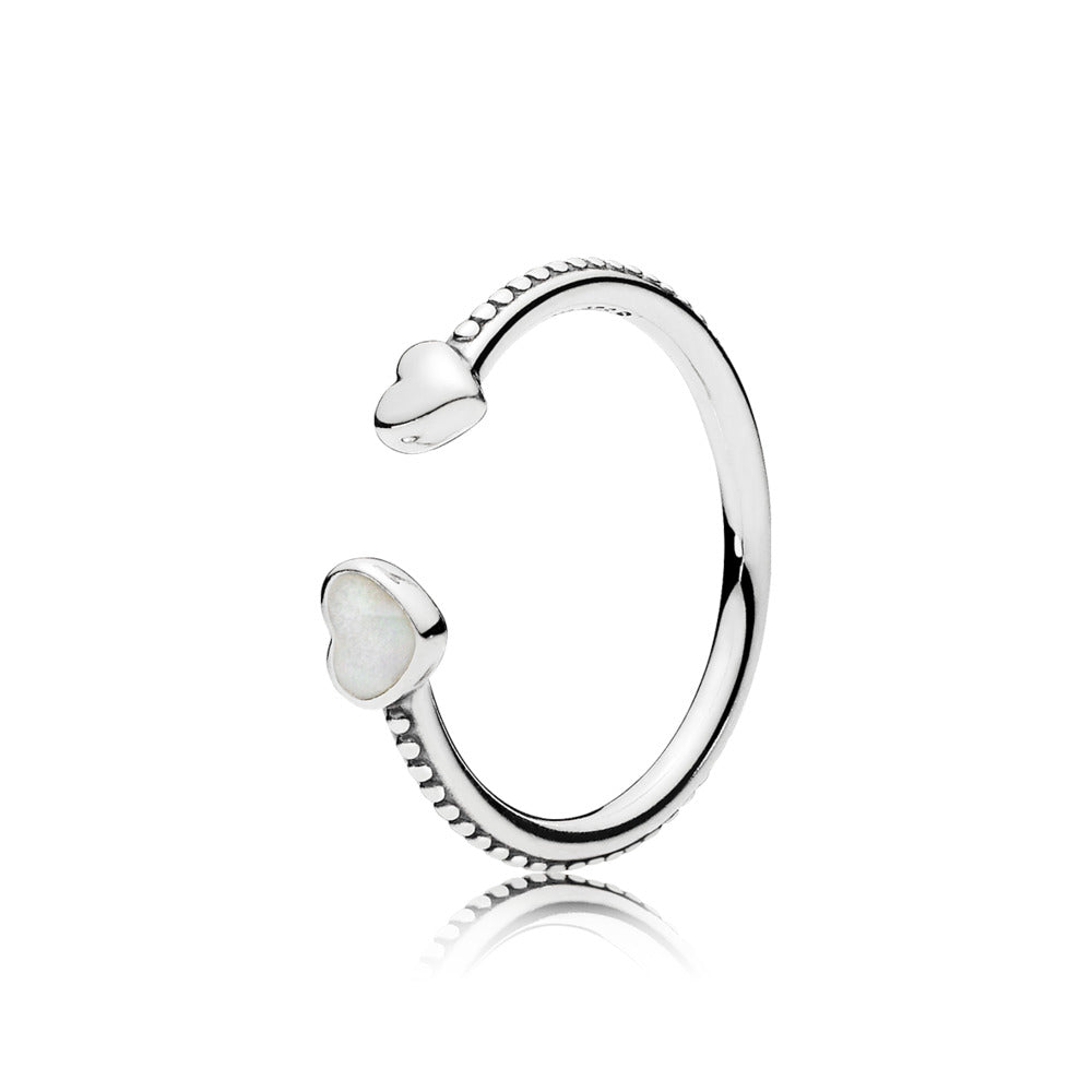 A Pandora ring with a heart on each end.