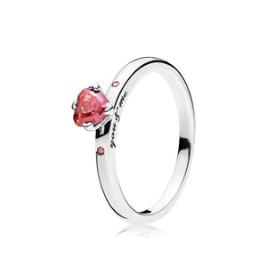 Heart ring in sterling silver with 1 prong-set heart-shaped step dome-cut red cubic zirconia, 1 flush-set fancy pink cubic zirconia, 1 flush-set fuchsia pink cubic zirconia and engraving You & me