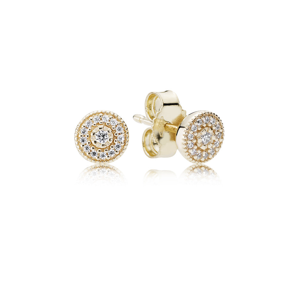 A pair of gold studs by Pandora.