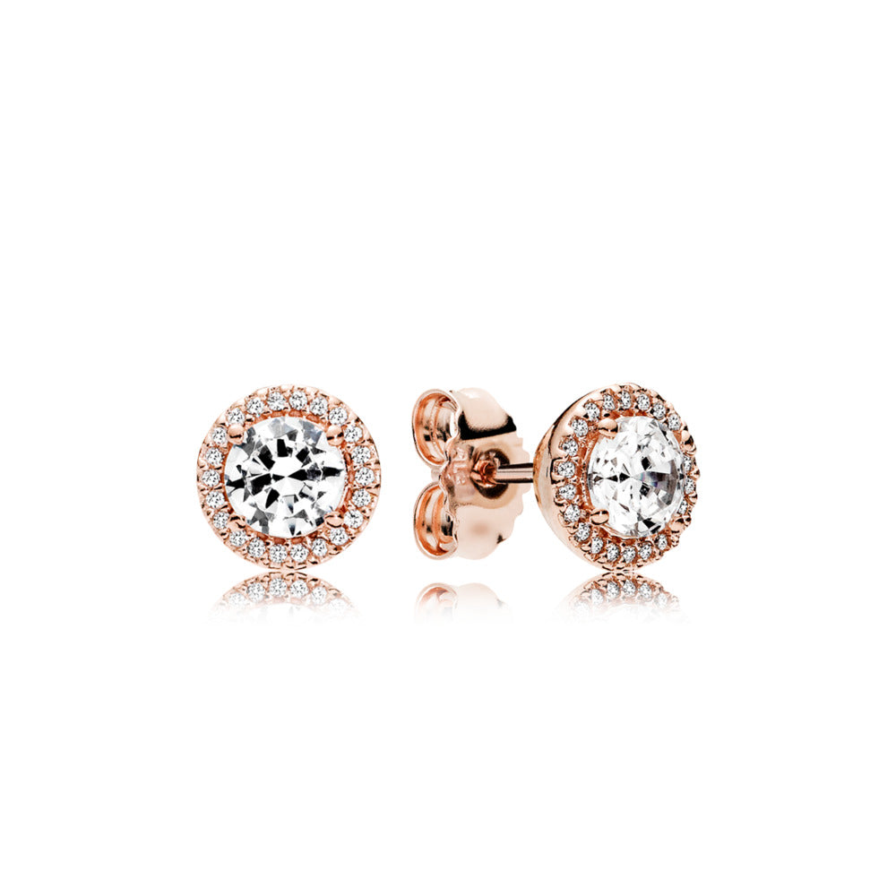 Stud earrings in PANDORA Rose with clear cubic zirconia