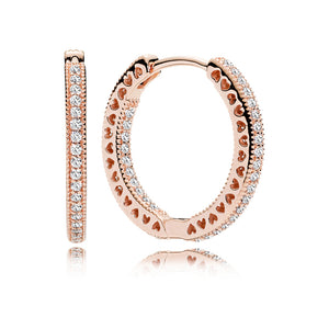 A pair of rose gold hoop earrings with hearts by Pandora.