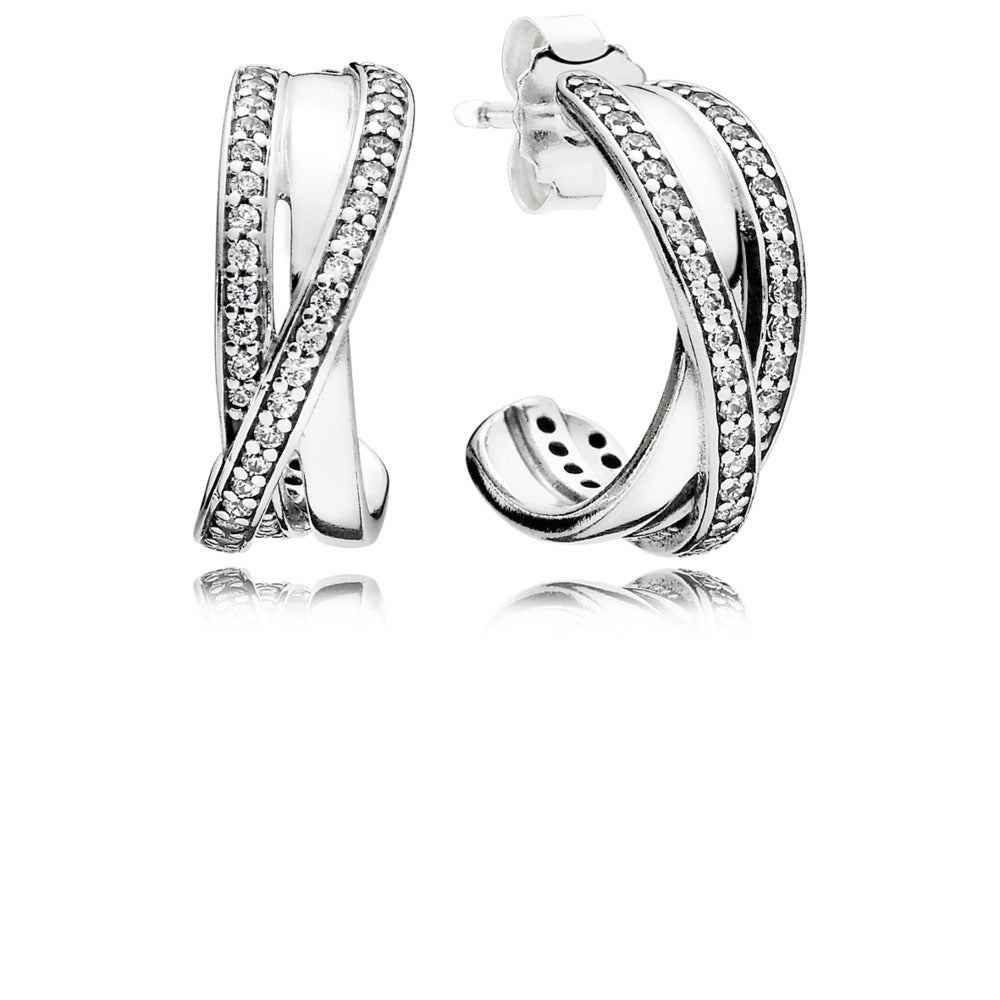 A pair of earrings with cubic zirconia on it by Pandora.