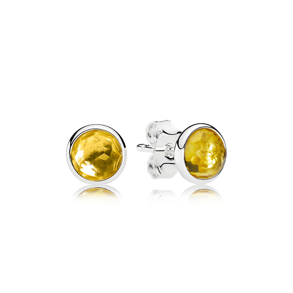 A pair of silver pandora studs with Citrine Centers.