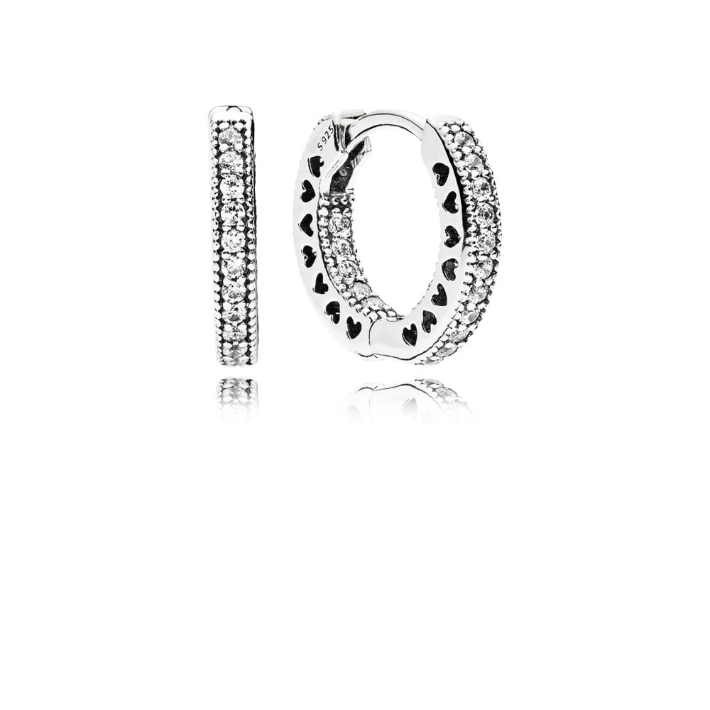 A pair of silver hoop earrings with hearts by Pandora.